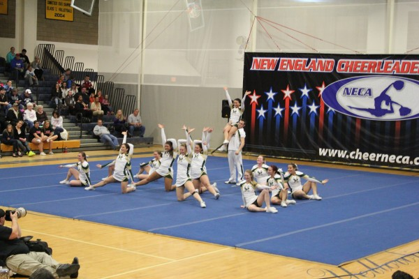 The Husson University cheerleading team strikes its final pose after hitting their entire routine without any deductions during the New England Cheerleading & Dance Team Open Championships Saturday in East Haven, Conn.