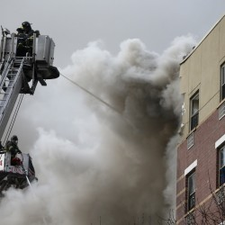 Explosion attributed to gas leak kills 6 in NYC; others missing