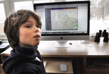 William Colglazier, 9, gathers information for his mobile application.
