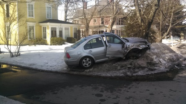 Hampden police say the driver of a Volkswagen Jetta was lucky no one, including himself, was injured when his car veered across a lane of traffic, launched off a snowbank and struck a tree after the driver dropped his phone and became distracted trying to pick it up on Saturday.