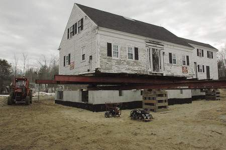 The 1795 Burnham farmhouse was moved on to its foundation last week as a phase of the Arundel Historical Society's North Chapel Common project.
