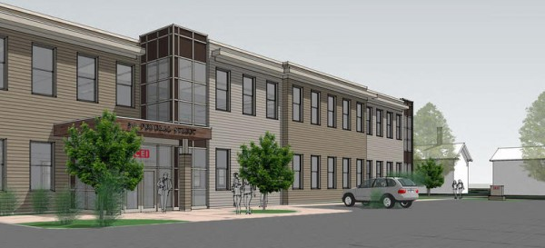 A view of Coastal Enterprises' proposed two-story headquarters on Federal Street in Brunswick from its large parking lot between Bank and Center streets.