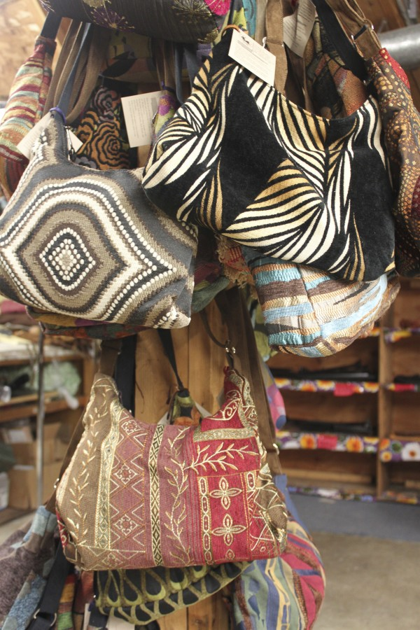 A selection of Erda handbags made of new furniture upholstery are displayed in Erda's headquarters in Cambridge in this January 2012 file photo