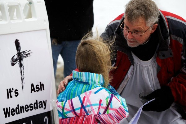 Episcopal priest Larry Weeks blesses a girl in Portland's Monument Square on Ash Wednesday.