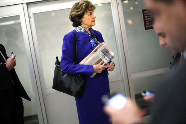 U.S. Senator Dianne Feinstein, D-Calif, waits for a subway car with aides as she returns to her office after a floor speech aimed at the CIA's handling of documents related to the Senate Intelligence Committee, at the U.S. Capitol in Washington on Tuesday. She said the Senate Intelligence Committee did not hack into CIA computers to obtain an internal report on interrogations and detentions.