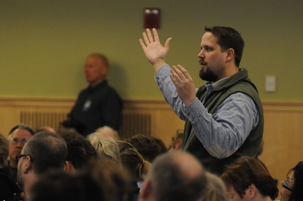 Justin Hafford from the division of lifelong learning at UMaine in Orono asks University of Maine President Paul Ferguson about budget cuts during a campus meeting on Friday.