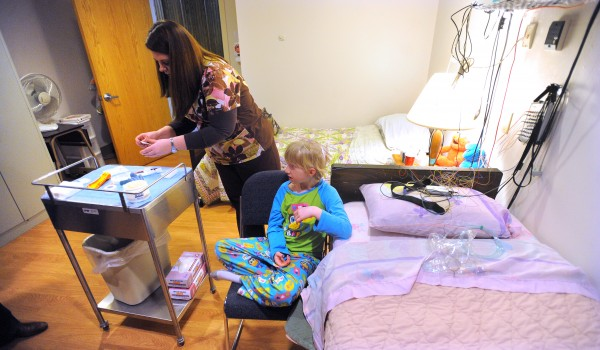 Technician Vanessa Brown gets equipment ready for a sleep study for Emma Brasier, 8, of Cambridge at the Sears Sleep Center in Bangor.