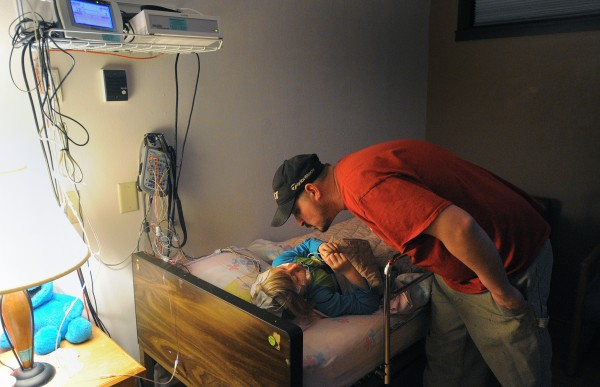 Wendell Brasier kisses his daughter Emma, 8, goodnight as they both prepare to take part in sleep studies at the Sears Sleep Center in Bangor. Emma was at the center to help to determine if her enlarged tonsils are obstructing her airway at night.