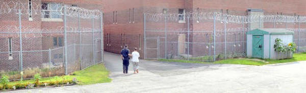 A prisoner is brought down the &quotrunway&quot into one of the buildings on the sprawling complex at the Maine Correctional Center in Windham in this 2013 photo.