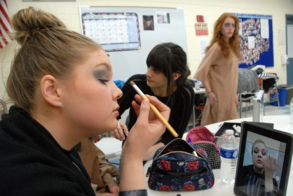 Dover-Foxcroft Academy senior Leah Ward puts on her makeup as Racquel Bozzelli (center) helps another actress prepare for a regional one-act drama competition at Stearns High School of Millinocket on Saturday, March 8, 2014.