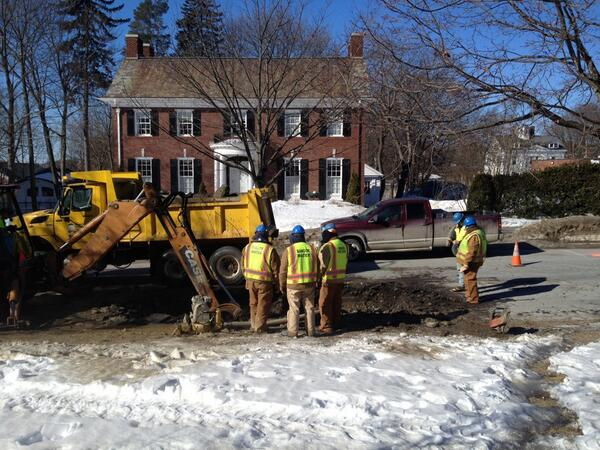 Bangor Water District officials work to rectify a water main break on Broadway near John Bapst High School Thursday.