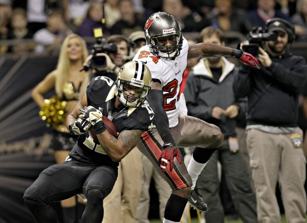 New Orleans Saints wide receiver Robert Meachem (17) hauls in a 41-yard pass for a touchdown against Tampa Bay Buccaneers cornerback Darrelle Revis (24) during the second quarter at the Mercedes-Benz Superdome in New Orleans on Sunday, Dec. 29, 2013.