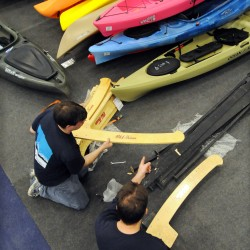 Old Town Canoe employees Chris Hopper (left) and Jeremy Smith assemble a display as part of the Old Town Canoe booth at the 76th Eastern Maine Sportsmen's Show to be held at the University of Maine in Orono over the weekend. The show, which is run by the Penobscot Valley Conservation Association, will be open from 9 a.m. to 8 p.m. Saturday and from 9 a.m. to 3 p.m. Sunday. Admission is $8 for those 12 years old and older, and free for those younger than 12.