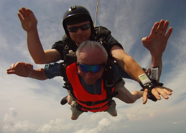 90-year-old Lester Slate, bottom, of Exeter sky dives tandem with instructor Matt Reindeau at Central Maine Skydiving in Pittsfield on Sunday, July 15, 2012.