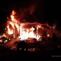 Fire destroys shed; nearby house spared