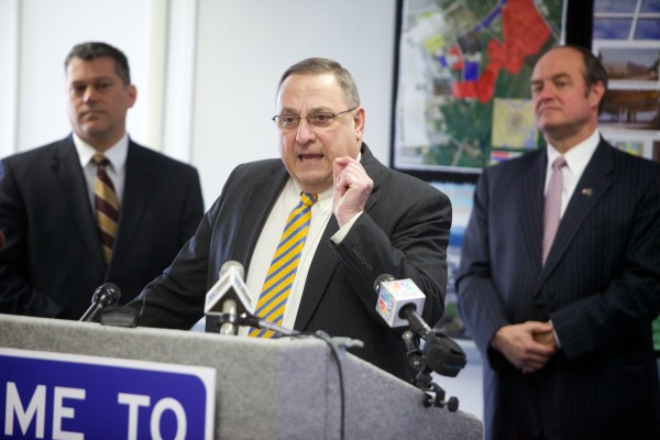 Gov. Paul LePage makes a pitch to shrink the power of Maine's labor unions while offering details about his &quotOpen for Business zones&quot proposal at a press conference in Brunswick on Monday. He was flanked by George Gervais, commissioner of the Maine Department of Economic & Community Development, (right) and Sen. Andre Cushing, R-Hampden.