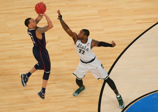 UConn's Shabazz Napier shoots the ball over Michigan State's Branden Dawson during the second half of the East Regional final of the NCAA Tourney Sunday at Madison Square Garden in New York.