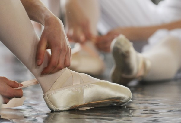 A student dancer fastens ballet slippers before a dress rehearsal on Saturday for &quotMozart's Madness,&quot part of &quotRobinson Ballet LIVE 2014.&quot