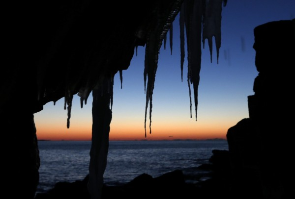 Icicles are silhouetted by the morning sky at Acadia National Park.