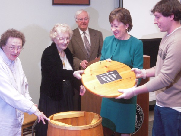 Aroostook County historians Nancy Roe, Anna Mcgrath and John Martin help County natives Sen. Susan Collins and Bradley Wilson open a potato barrel time capsule sealed during the Sesquicentennial of Aroostook County. The barrel was opened March 16, 2014 for the county's 175th anniversary celebration.
