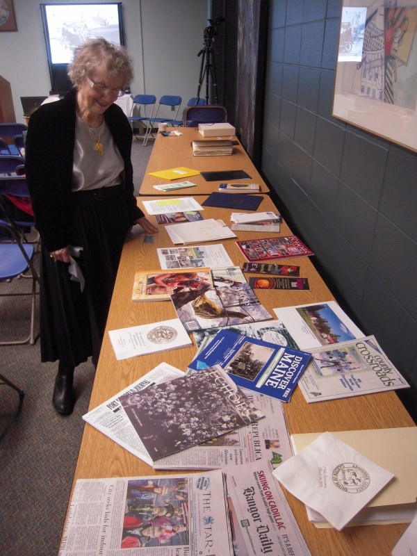 Former librarian Anna Mcgrath who helped found the Friends of the Aroostook County Historical Center examines items representing the year 2014 that were sealed in a time capsule March 16 to be opened in 2039 on the county's 200th anniversary.