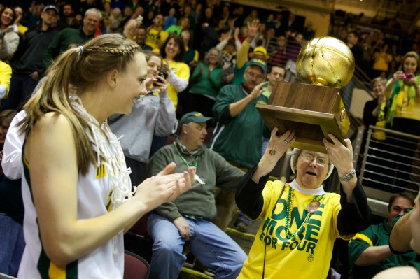 Catherine McAuley High School basketball co-captain Olivia Smith (left) presents the gold ball to Sister Edward Mary Kelleher on Saturday at the Cumberland County Civic Center in Portland. McAuley had just bested Oxford Hills Comprehensive High School for the Class A state championship.