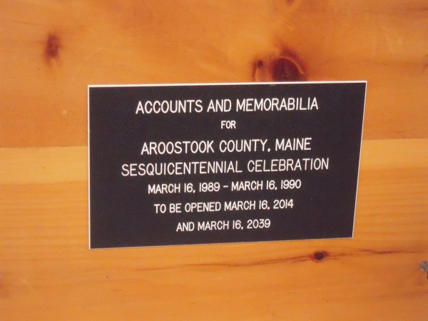 A placard attached to a potato barrel time capsule sealed during Aroostook County''s Sesquicentennial dictates the barrel be opened March 16, 2014 as Aroostook County celebrates its 175th anniversary and in 2039 for its bicentennial.