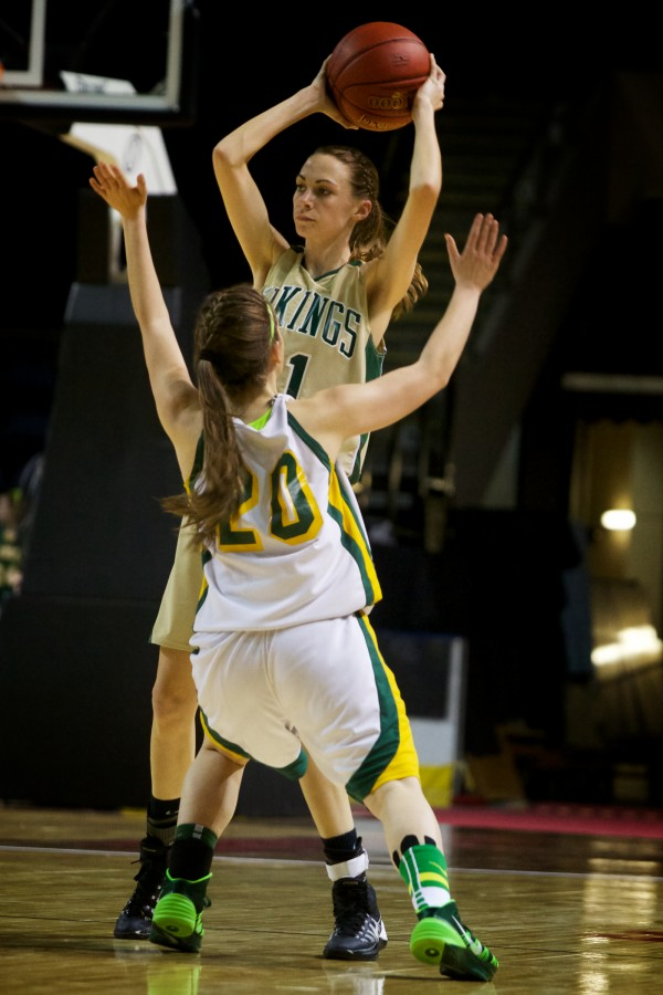 Oxford Hills Comprehensive High School's Mikayla Morin looks to make a pass on Saturday during the Class A state championship basketball game in Portland against Catherine McAuley High School's Olivia Delphonse at the Cumberland County Civic Center.