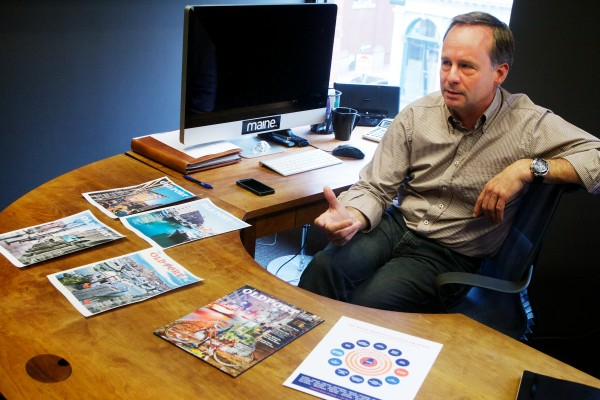 Kevin Thomas, publisher of Maine magazine, shows mock-up covers of his company's newest venture called Old Port magazine on Wednesday in Portland. The quarterly publication will hit the streets in June and will focus only on Portland's peninsula.