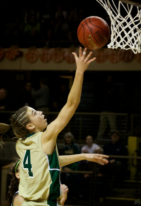 Forward Anna Winslow of Oxford Hills Comprehensive High School shoots a layup in the Class A state championship game Saturday in Portland. Her team lost to Catherine McAuley High School.