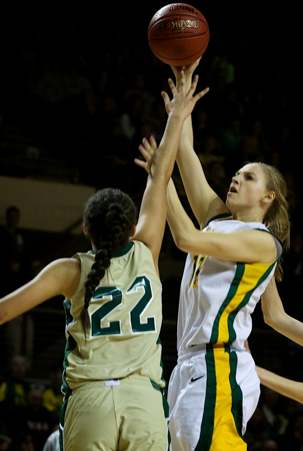 Catherine McAuley High School girls basketball co-captain Olivia Smith shoots over an Oxford Hills Comprehensive High School defender Saturday in Portland. The McAuley Lions beat the Vikings in the Class A state championship game at the Cumberland County Civic Center.