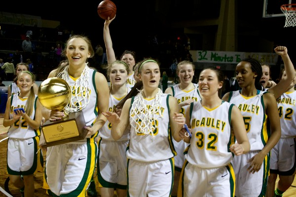 The Catherine McAuley High School girls basketball team leaves the court with the gold ball after beating Oxford Hills Comprehensive High School in the Class A state championship game on Saturday at the Cumberland County Civic Center in Portland.