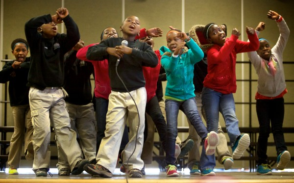 The African Children's Choir performs onstage at the East End Community School in Portland on Monday. The choir, in the 13th month of 16 month tour, also had time to have lunch and play with children at the school.