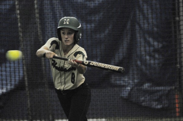 Husson University's Mallory Conary bunts the ball against Brandeis University during Saturday's softball doubleheader at  UMaine's Mahaney Dome in Orono.