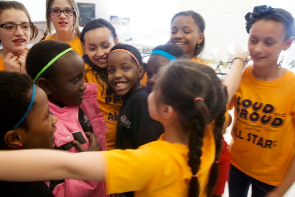 A call for a group hug is made as African Children's Choir members say goodbye to East End Community School students in Portland on Monday after a performance.