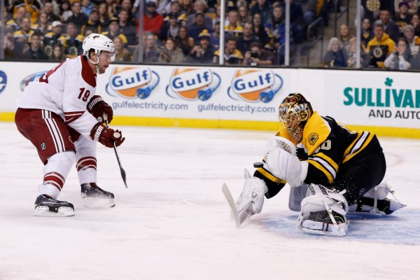 Boston Bruins goalie Tuukka Rask (40) saves a shot by Phoenix Coyotes right wing Shane Doan (19) during the second period at TD Banknorth Garden in Boston Thursday night.