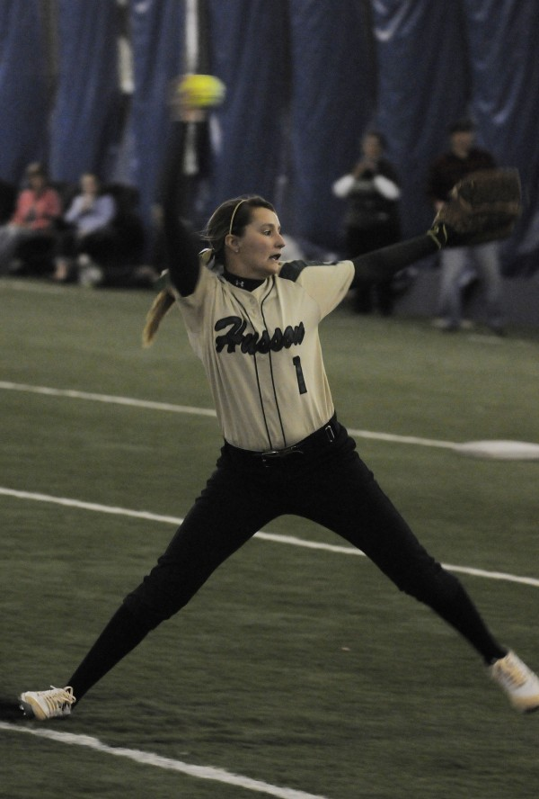 Husson University's Kayla Merrill pitches against Brandeis University during Saturday's softball doublehader at UMaine's Mahaney Dome in Orono.