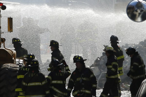 New York City emergency responders search through the rubble at the site of a building explosion in the Harlem section of New York, on Thursday.