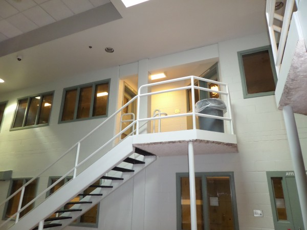 This image, provided by the Cumberland County Sheriff's Office, shows the second story landing connecting the women's section of the county jail's maximum security area to the left, and the door to the men's section of the area on the right.