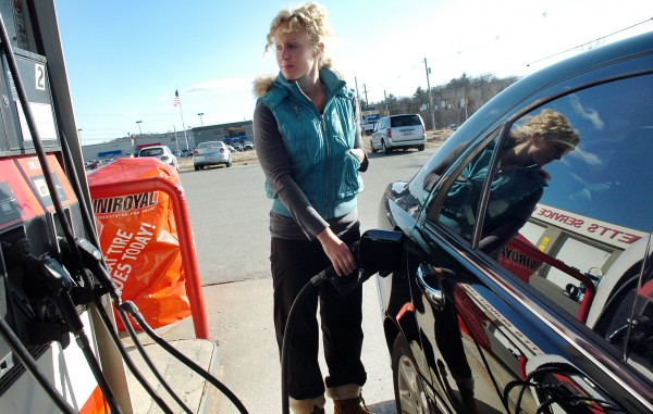 A Bangor resident fills up at Swett's Tire and Auto in Bangor in this March 9, 2010, file photo. The average price of regular gasoline in Maine remained basically flat last week at an average of $2.10 per gallon, as the national average fell.