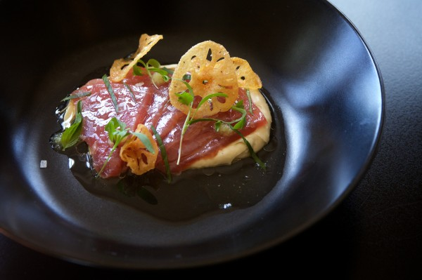 A yellowfin tuna with kaffir coconut creme, lotus root chips, Thai basil and cilantro is served at lunch at Tao Yuan in Brunswick on Friday.