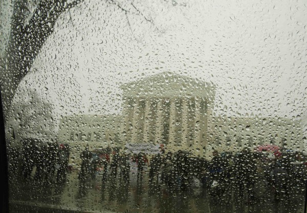 The Supreme Court is seen from within a car as snow melts on the window during a light snow falling last week.