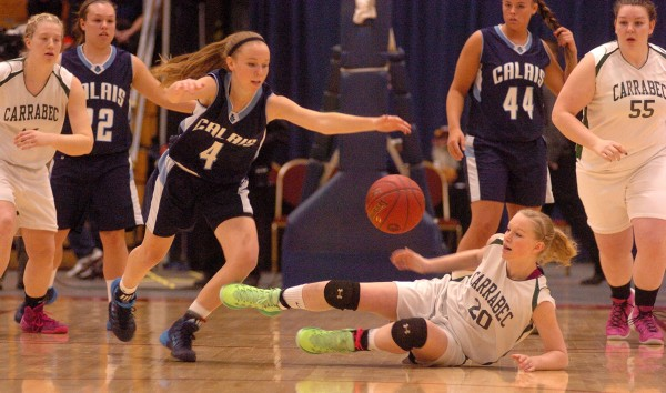 Calais High School's Madison McVicar (left) presses for a loose ball against Carrabec High School's Hannah Atwood (center) during the girls Class C state championship basketball game Saturday night in the Augusta Civic Center.