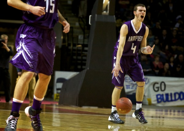 Hampden Academy guard Nicholas Gilpin calls a play Saturday night at the Class A state championship game in Portland.