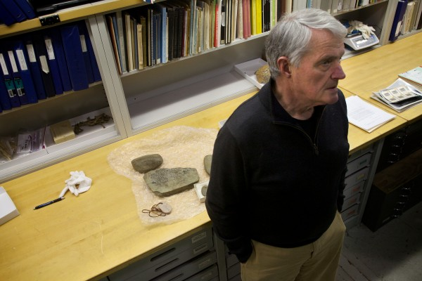 Dr. Bruce Bourque, a professor at Bates College and longtime state archaeologist, talks about the Spirit Pond rune stones on the counter behind him at his office in Augusta on Wednesday. &quotI took them to a Harvard linguist named Einer Haugen, and in about 10 seconds, he said, 'They're fakes, and in fact, they're clumsy fakes,'&quot said Bourque.