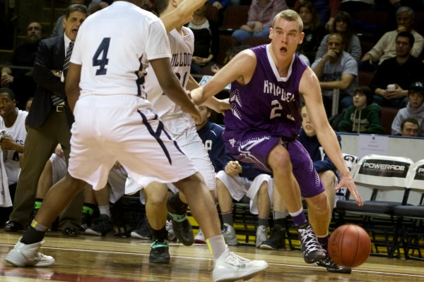 Hampden Academy senior Zach Gilpin dribbles toward the basket Saturday night in Portland during the Class A state championship game against Portland High School. Hampden lost 54-40.