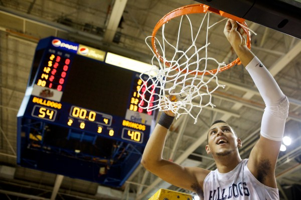 Portland High School senior Matt Talbot cuts down the net at the Cumberland County Civic Center Saturday night after his Portland High School Bulldogs defeated the Broncos of Hampden Academy for the state Class A basketball championship.