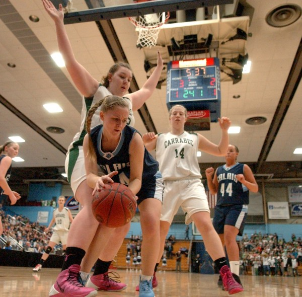 Calais High School's Mallory Black (center) scrambles after picking up a loose ball and rebound against Carrabec High School's Emma Pluntke (left) and Macy Welch (right) during the girls Class C state championship basketball game Saturday night in the Augusta Civic Center.