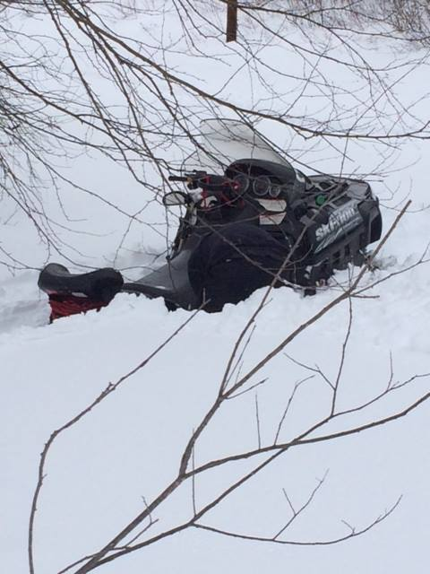 Snow is deep in the north Maine woods. An attempt at grooming her trails by BDN reporter Julia Bayly earlier this month ended with a very stuck snowmobile after the machine slid off the trail into the soft snow.