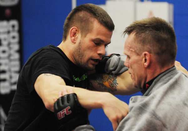 Mixed martial arts fighter Ryan Sanders (left) trains with instructor Pat Kelly at Young's MMA in Bangor on Thursday.